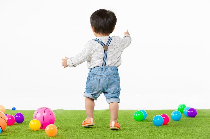 Studio Portrait Of Backside Of Adorable, Asian Toddler Boy Weari